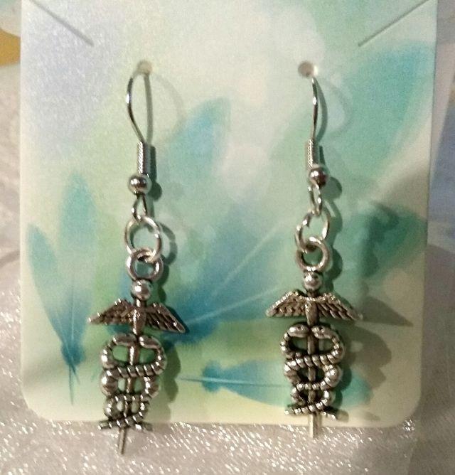 Brand new pierced earrings in package