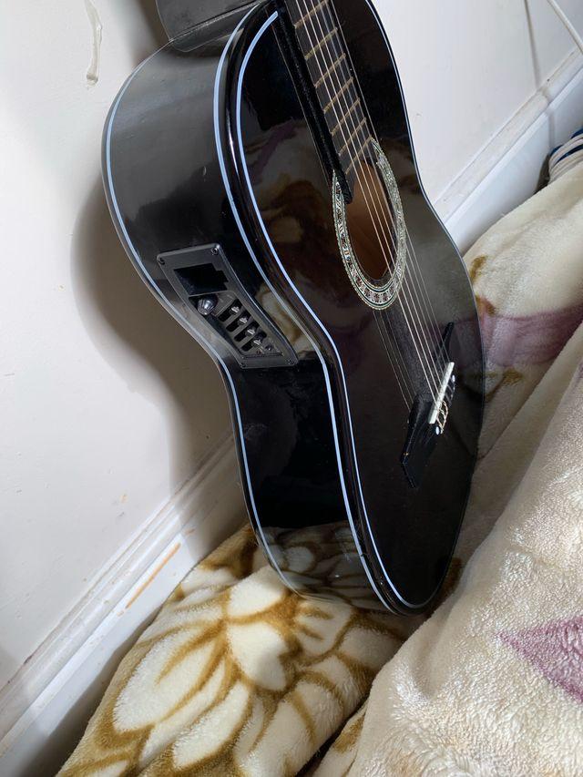 Classic black acoustic guitar