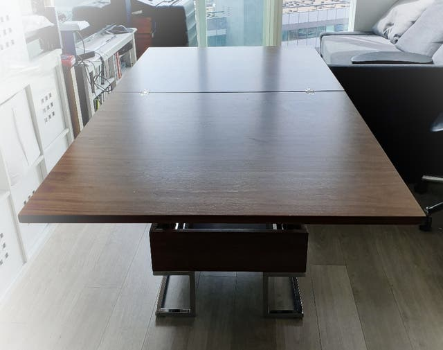 Dwell expanding Coffee Table to Dining table