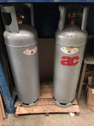 Envases Refrigerante de 55Kgrs y Expositor Bebidas