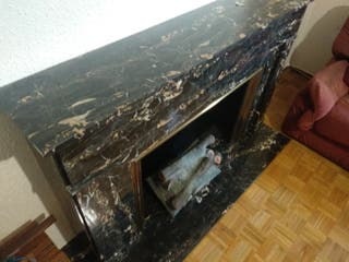 Frente de chimenea de marmol negro