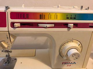 Màquina de coser elèctrica Singer
