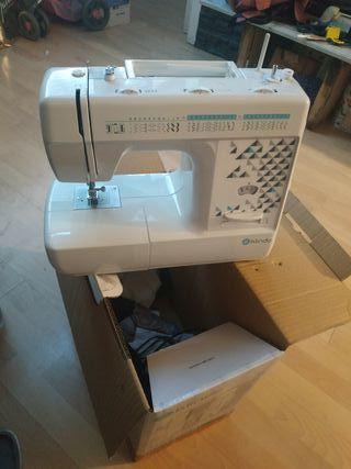 Máquina de coser klindo