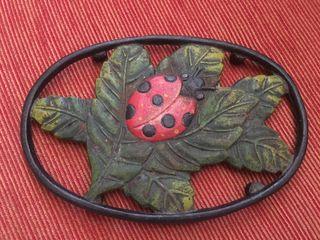 Salvamantel de hierro fundido mariquita nuevo