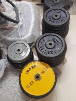 Discos y barras gimnasio