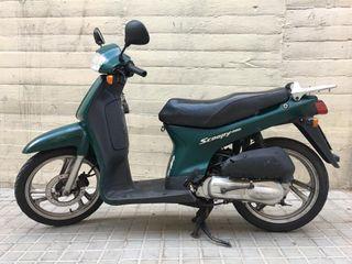 Honda scoopy 50 cc.