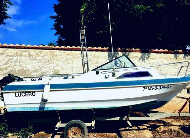 barco , remolque y motor