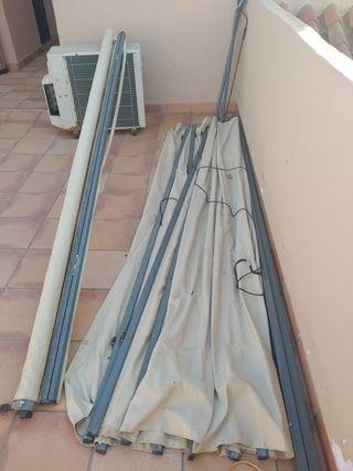 Toldo y aparato de aire acondicionado