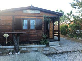 mobilhome y cabaña de madera en Camping Piscis