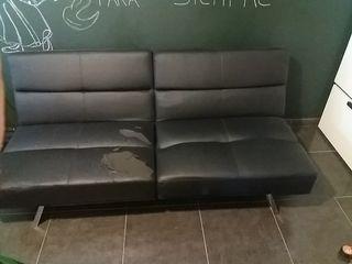sofá cama, en negro. Desmontable se hace puff 85 x