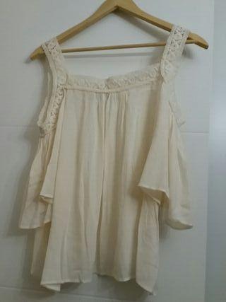 blusa blanca tirante con manga