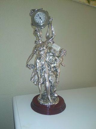 figura ,escultura reloj de plata, Mamely