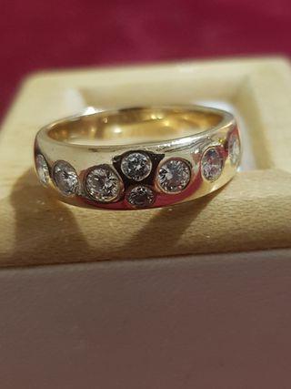 precioso anillo de oro y diamantes