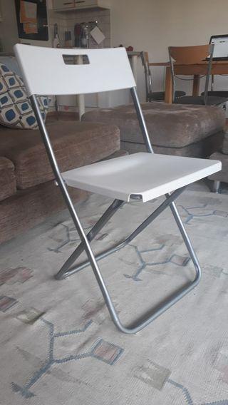4 Ikea white folding chairs. Garden & dinning room