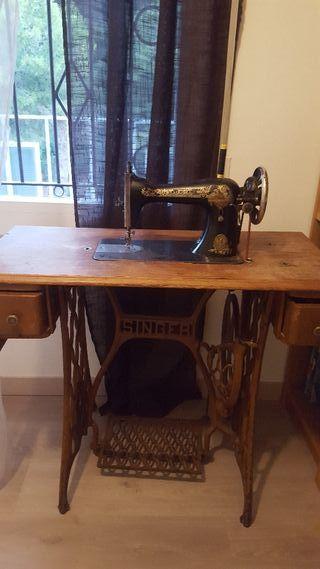 máquina antigua coser singer.