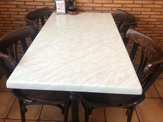 Mesa de comedor con pie de hierro forjado