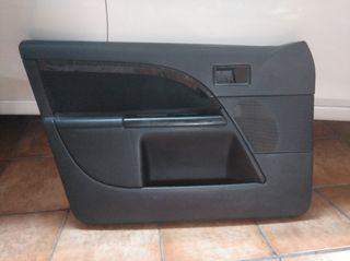 Tapizado puertas ford mondeo. Interior madera