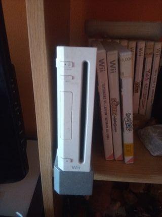 Nintendo Wii con un mando