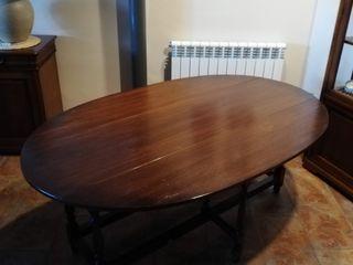 Mesa comedor ovalada y plegable de madera oscura