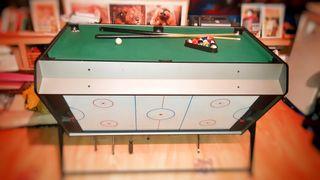 mesa pequeña de billar y hockey por aire
