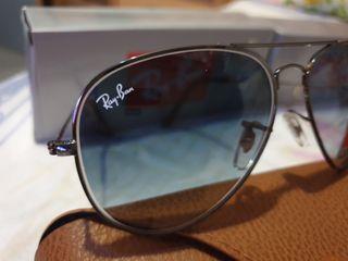 gafas rayban lente azulada,marron,gris.