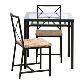 Mesa y dos sillas de salón Ikea. Hierro y mimbre