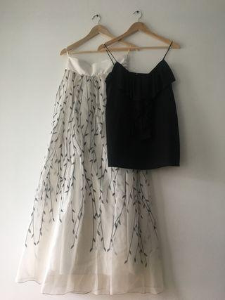 Falda larga, blusa y bolso