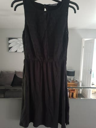 still new a lovely ladies black dress size 10.