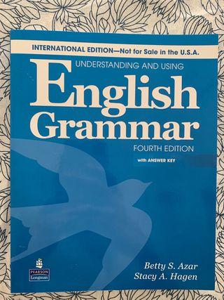 Libro y cuaderno de gramática de inglés