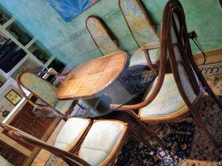 mesa cristal y rattan y 6 sillas