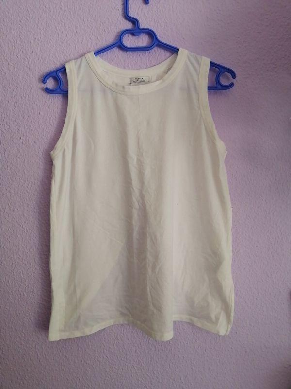 código promocional vendible oferta especial Camiseta blanca con apertura por detrás de segunda mano por ...