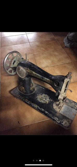 Maquina se coser singer,