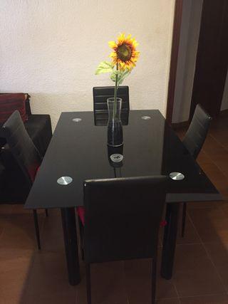Mesa de comedor de cristal negra