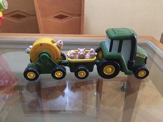 Tractor musical con cerditos