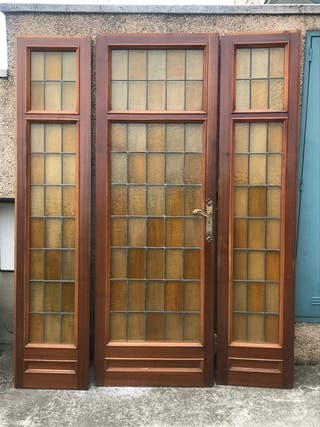 Puerta madera maciza y cristal