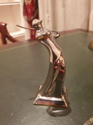 Figura golfista de oro