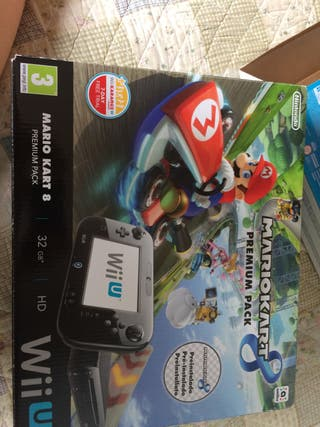 Wii U + 3 juegos + 2 fundas + Mando + Pilas