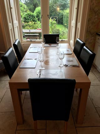 Extending Wooden Table and 6 faux leather chairs