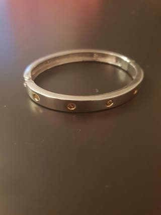 Pulsera unisex estilo Cartier de acero y oro