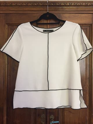 Preciosa blusa corte Chanel