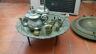 antigüedades bronce y planta