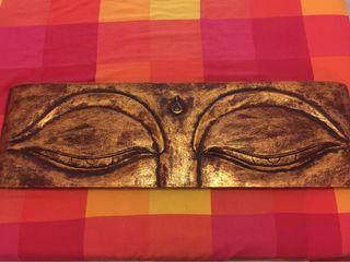 Cuadro tallado en madera ojos buda