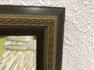 Espejo biselado con marco