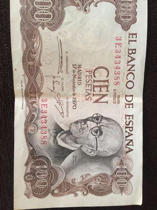 Monedas y billete de 100 pesetas