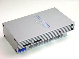 PlayStation 2 con mando, Manta y 2 juegos