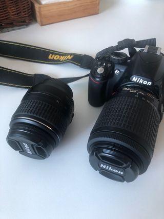 Nikon 3100 más dos objetivos 18 / 55. Y 55/ 200