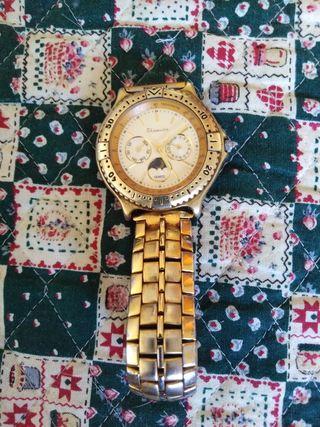 reloj chapado en oro