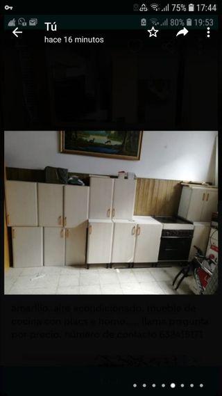 mueble de cocina y horno y placa eléctrica