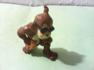 Figura de mono chulo con osito