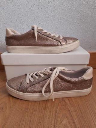Zapatillas doradas